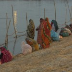 Women's worshiping mother ganga in kumbh mela 2013